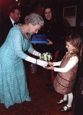 Mia Donn presents flowers to Her Majesty the Queen